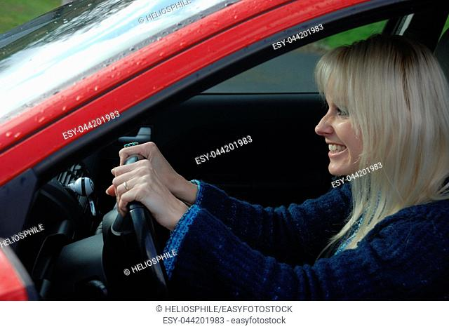 woman driving a red car