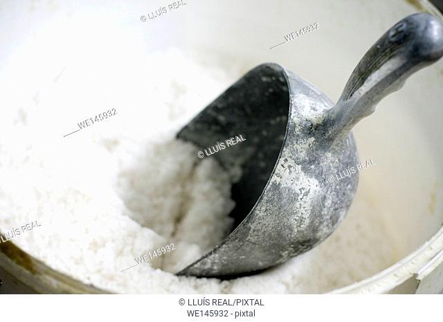 Close up of powdered sugar and metal shovel