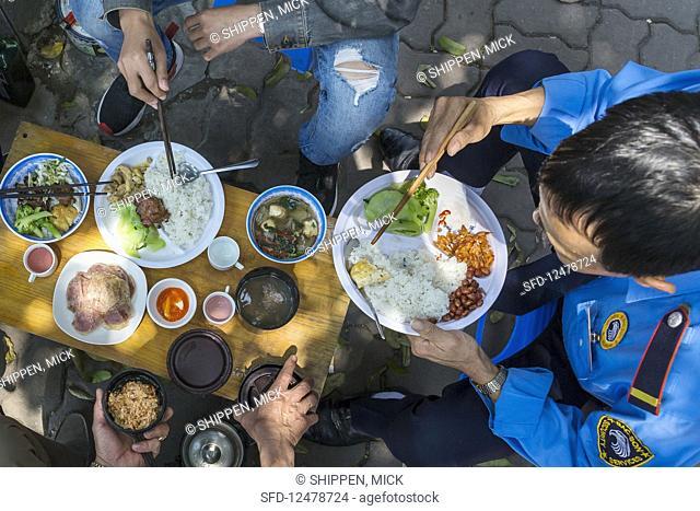 Vietnamese outdoor lunch (Hanoi, Vietnam)