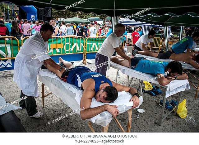 Runners, get the attention of the masseurs after the race. Climb to the Hermida Gorge. Potes. Cantabria. Spain