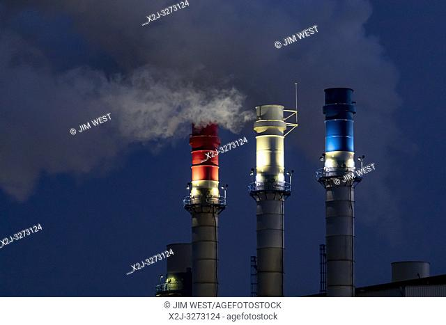 Dearborn, Michigan - Red, white, and blue smokestacks at the Dearborn Industrial Generation facility. The plant burns natural gas and waste blast furnace gas to...