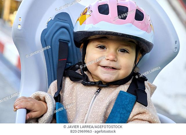 Baby with helmet on bicycle, Donostia, San Sebastian, Gipuzkoa, Basque Country, Spain, Europe