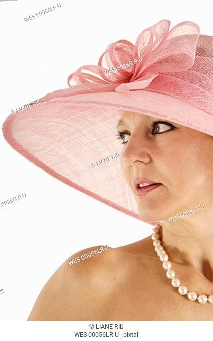 Woman wearing pink hat, portrait