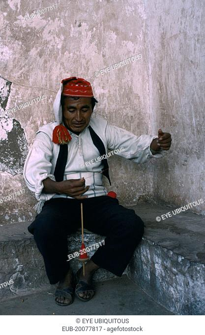 Taquile man spinning wool