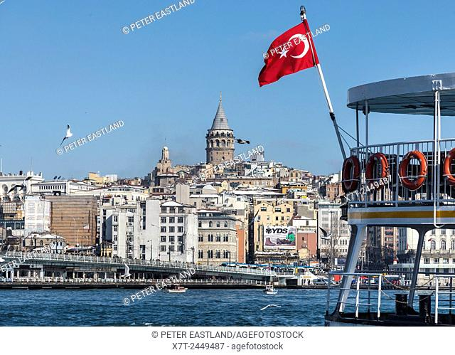 View from Eminonu across the Golden Horn toward Galata bridge with Galata tower and Beyoglu on the Istanbul skyline. Istanbul, Turkey