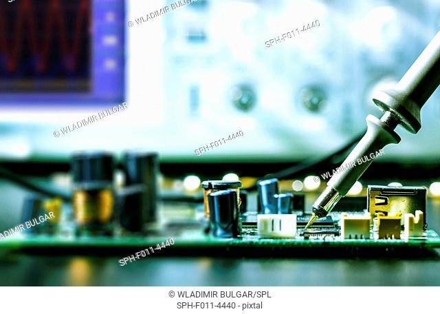 Soldering an electronic circuit board