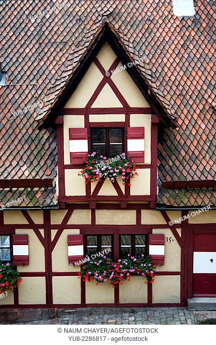 Detail of medieval red old house, Nuremberg, Nürnberg, state of Bavaria, Middle Franconia, Germany, Europe