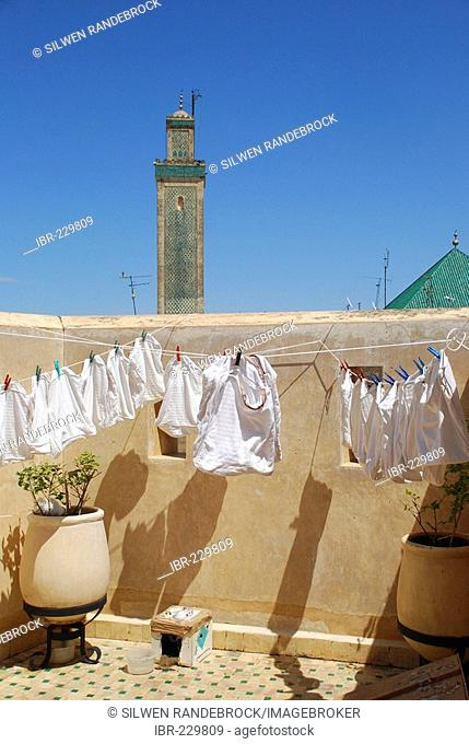 Laundry in the wind and minarett of the Kairaouine mosque Fez Morocco