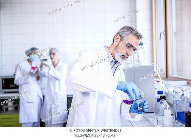 Scientist working with liquid in lab