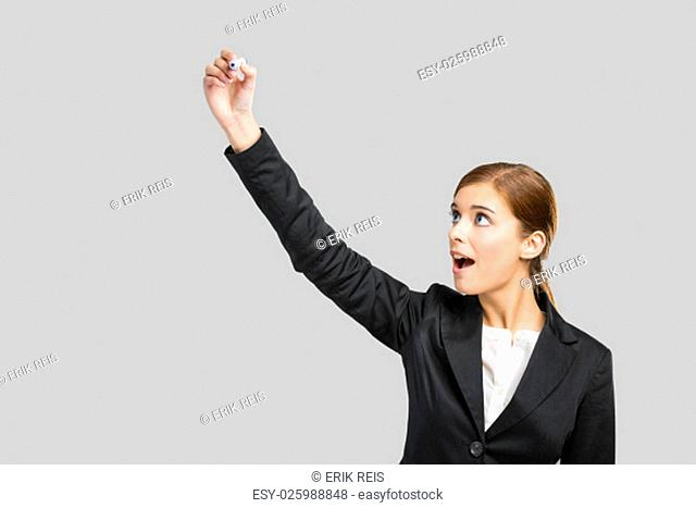 Beautiful businesswoman pointing