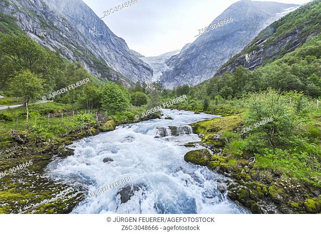 glacier Briksdalsbreen and its river, Norway, Jostedalsbreen National Park in the valley Oldedalen, Olden at the Nordfjorden