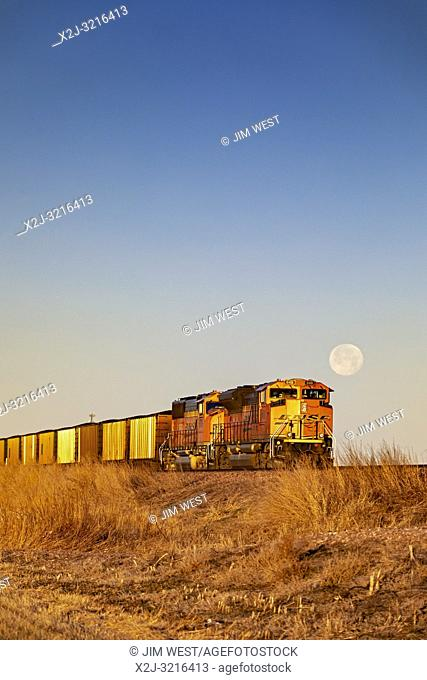Cairo, Nebraska - A BNSF coal train in the sand hills of Nebraska. Each day, as many as 100 coal trains, each about a mile long