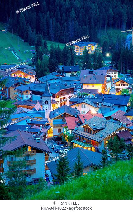 View over town at dusk, Canazei, Val di Fassa, Trentino-Alto Adige, Italy, Europe