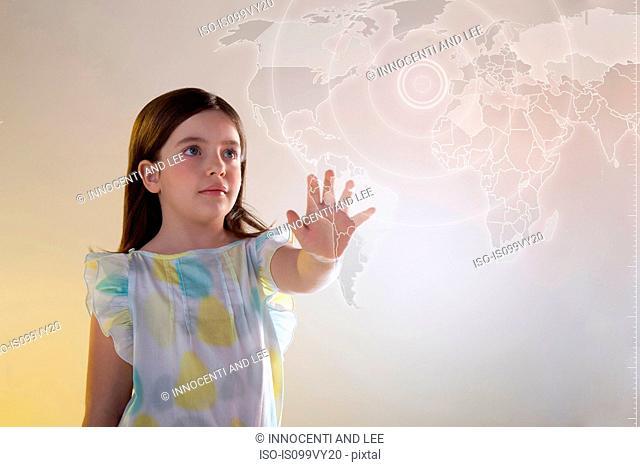 Girl touching virtual world map