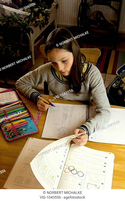 GERMANY, BERLIN, 08.11.2007, Girl is doing her homework. - BERLIN, BERLIN, GERMANY, 08/11/2007