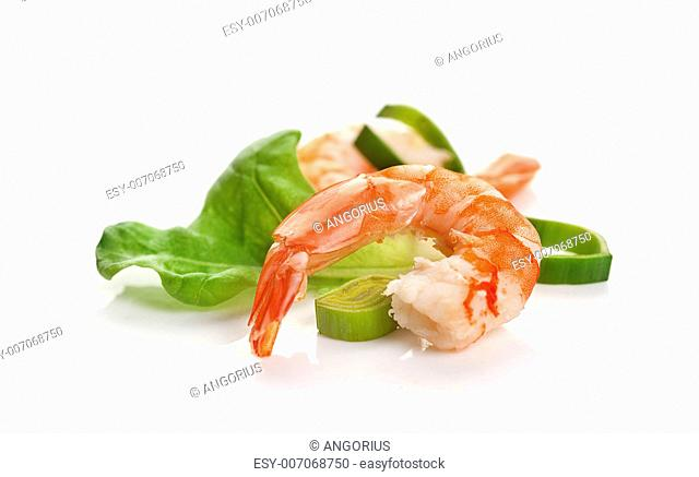 One boiled shrimp's tail with lettuce, leek and lemon on the white background
