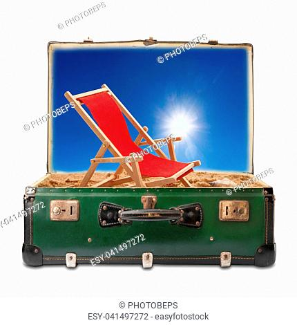 Old suitcase on sky background with summer concept