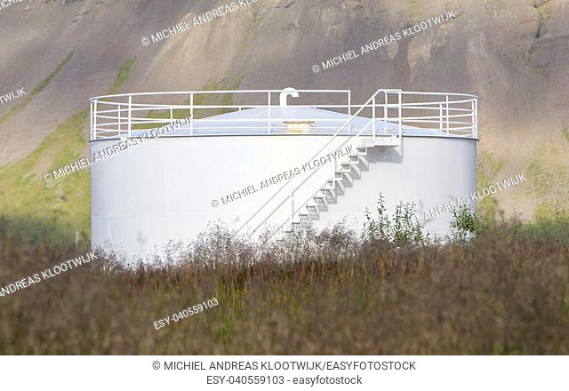 White gas storage tank in the west of Iceland