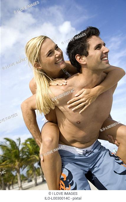 A young couple on a beach