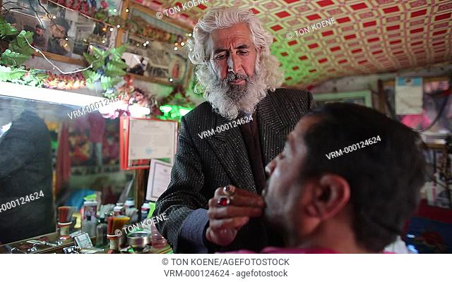 hair dresser at work in kabul, Afghanistan