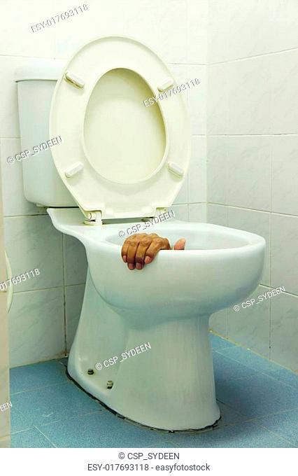 hand in toilet