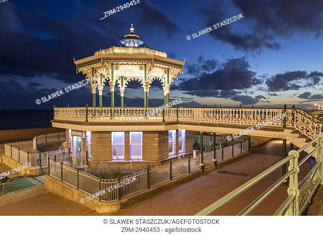 Night falls at Brighton Bandstand, East Sussex, England