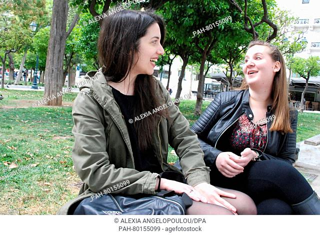 Students Elena (27) and Juli (L, 25) chat in Athens, 05 May 2016. Both women feel that the previous generations screwed up