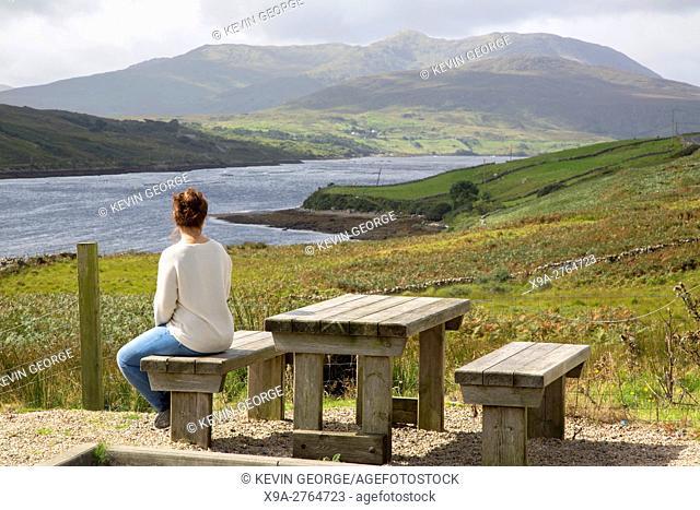 Young Woman looking at Killary Fjord Lake; Leenane, Connemara; Galway; Ireland