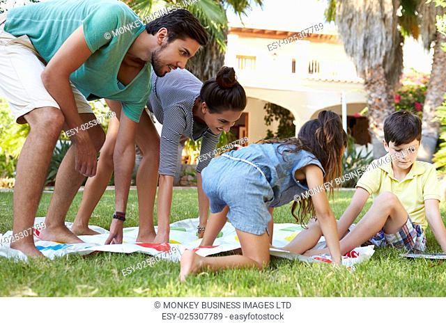 Family Playing Balancing Game In Garden