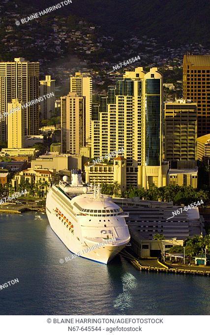 Princess Cruises' Regal Princess cruise ship docked in front of Downtown Honolulu, Oahu, Hawaii, USA