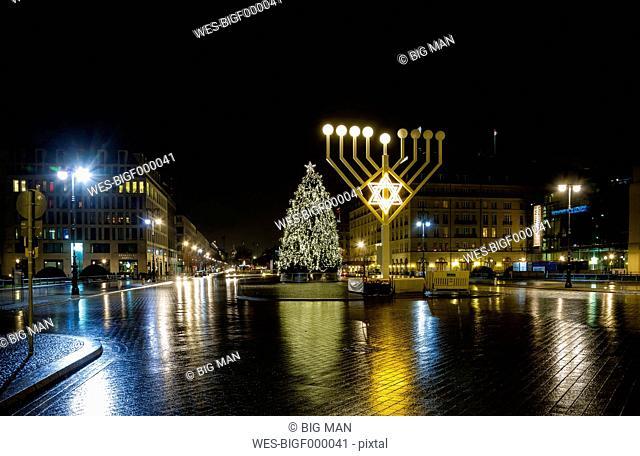 Germany, Berlin, giant Hanukkah menorah near Brandenburg Gate at night