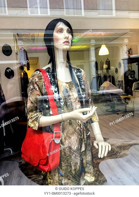 Tilburg, Netherlands. Mannequin dressed up in a fashion store shop window