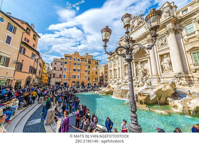 Trevi Fountain in a sunny day with crowd of people in Rome, Italy