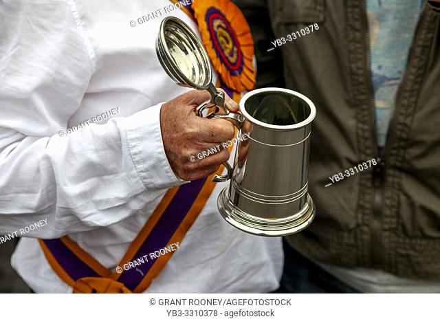 A Morris Dancer Holding A Traditional Beer Tankard During The Annual â. . Dancing in the Oldâ. . in Harveys Brewery Yard To Celebrate The Return Of The â