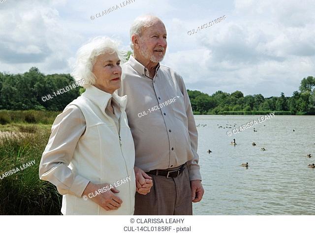 Elderly man holding elderly woman's hand
