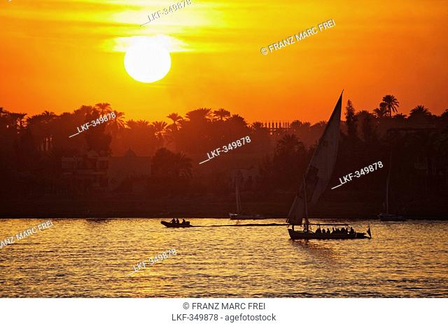 Feluccas and sunset on the river Nile, Luxor, formerly Thebes, Egypt, Africa