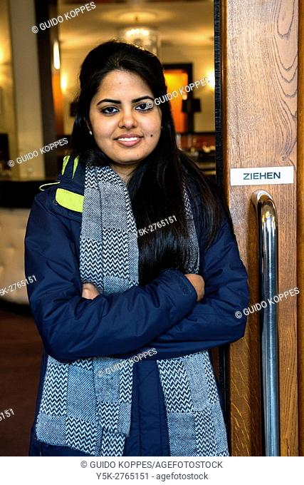 Aachten, Germany. Young Indian university exchange student visiting a down town museum