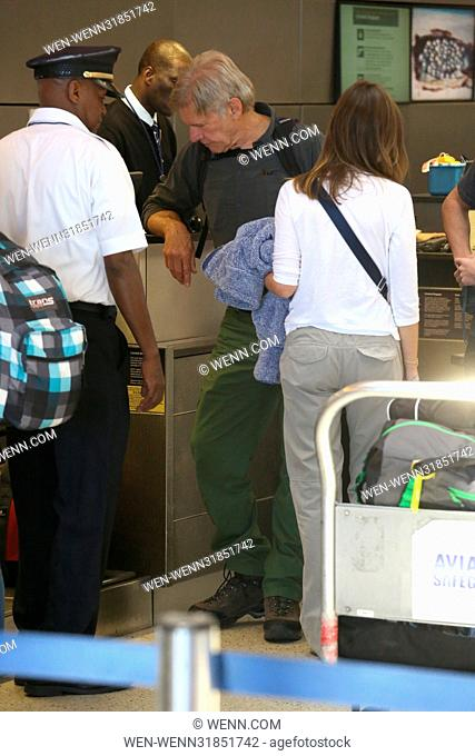Harrison Ford and Calista Flockhart arrive at Los Angeles International (LAX) Airport to catch a flight with their son Liam Featuring: Harrison Ford