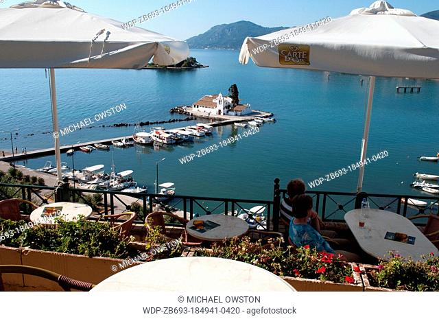 restaurant overlooking Monastery of Panagia Vlahernon on Vlacherna Island off the Kanoni Peninsular Corfu Greece