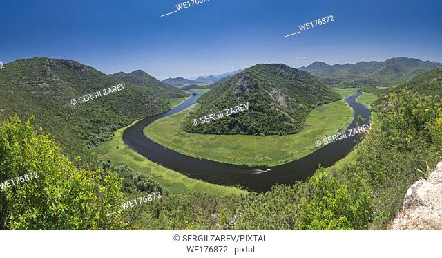 Panoramic view from above of the huge bend of Tsrnoyevicha river and the forest around, Rijeka Crnojevica in Montenegro