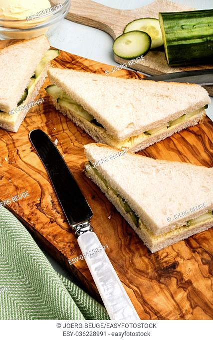 fresh made traditional english cucumber sandwich on a wooden board