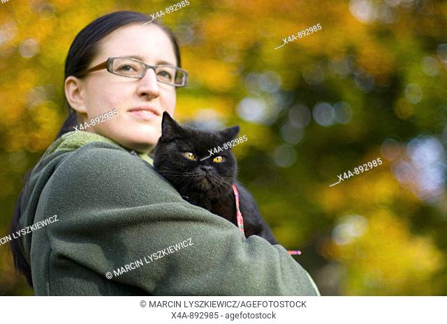 Woman with British shorthair cat