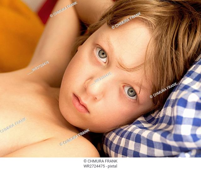 Portrait of a Boy with Blond Hair Looking