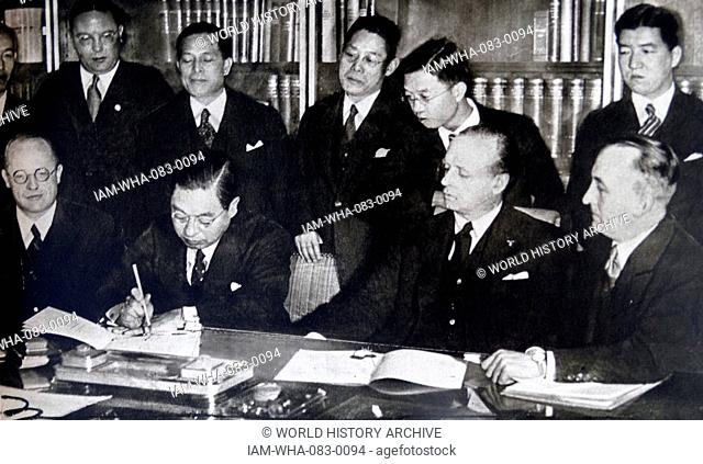 Photographic print of Japanese ambassador Kintomo Mushanokoji and foreign minister of Nazi Germany Joachim von Ribbentrop sign the Anti-Comintern Pact