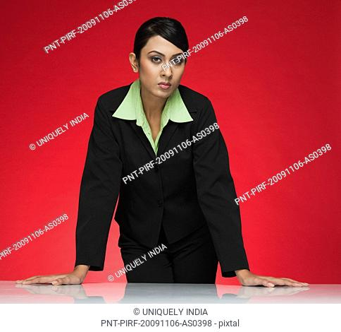 Portrait of a businesswoman standing at a conference table