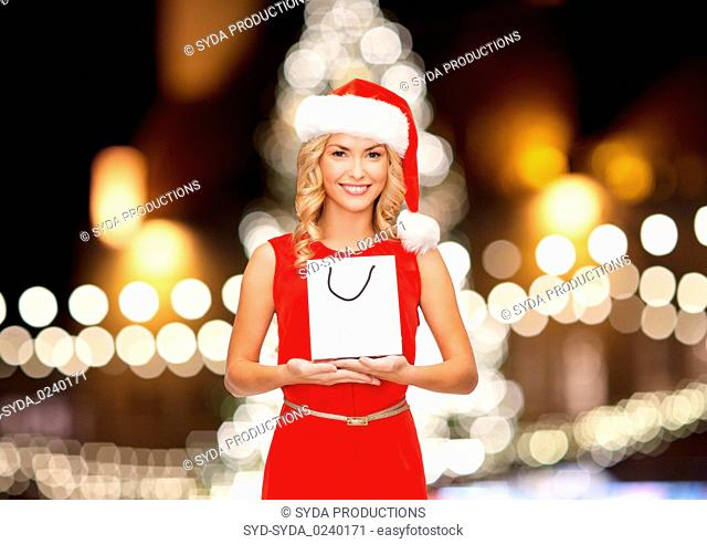 woman in christmas santa hat with shopping bag