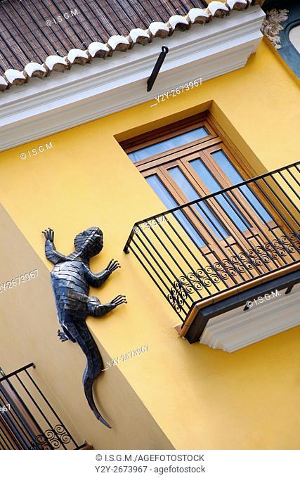 Metal salamander in a building. Valencia, Spain