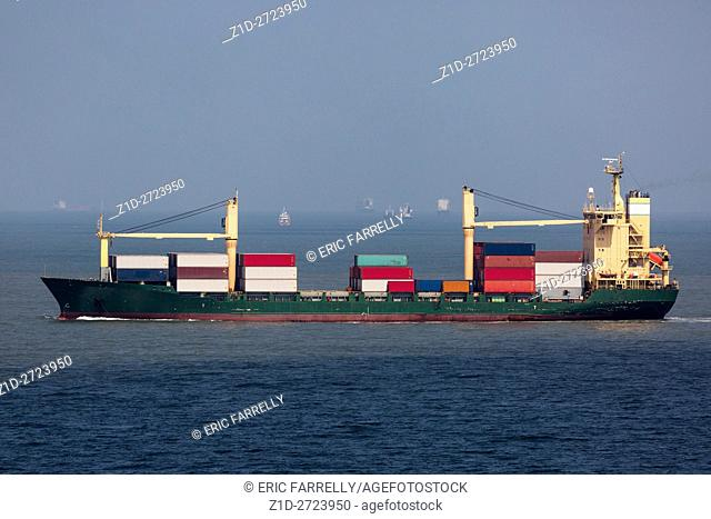 Container ship heading for Port Said passing other ships waiting for passage down Suez Canal Egypt