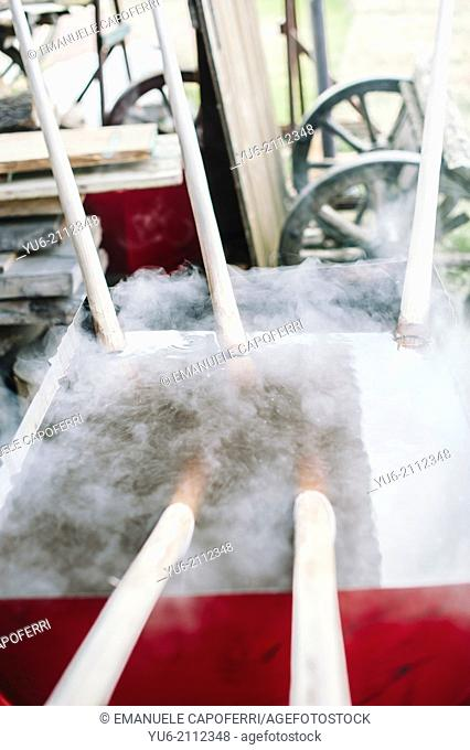 Ancient technique of boiling wood, to make it soft and pliable wood, Ispra, Varese, Italy