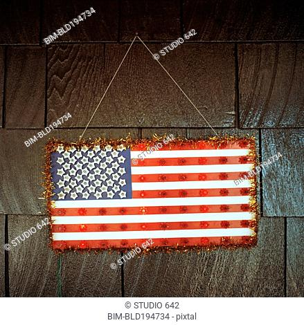 Handmade American flag hanging on wall